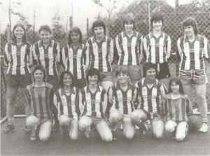 Reynolds (back row, far right) with her young Norwich Ladies charges, 1982.