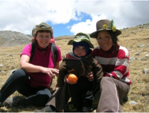Thomas shares her lunch with a Peruvian shepherdess and her young child, high in the Cordilleras Huayhuash mountain range in the Andes
