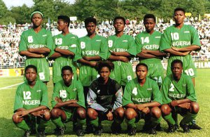 A football team of young black women wearing green kits
